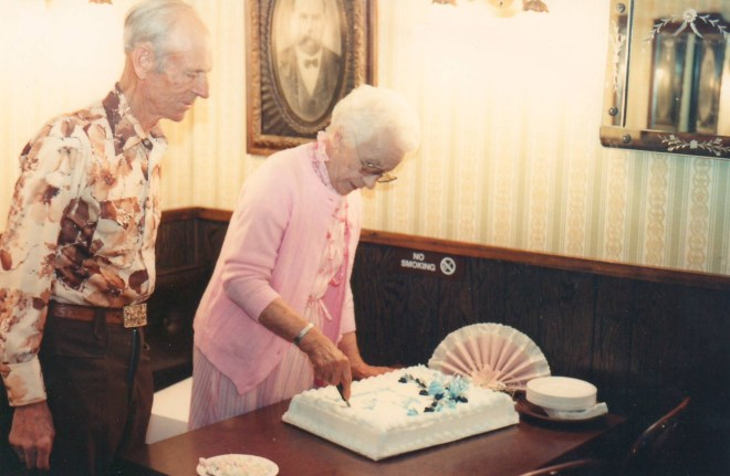 Cutting the cake at their 60th anniversary party